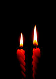 Two Red Candles Burning On the Black Background Stock Photos