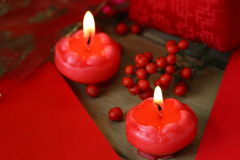 Two red candles burning. Red cards and red candles Stock Images