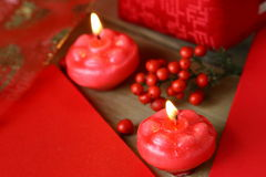 Two red candles burning. Red cards and red candles Stock Photography