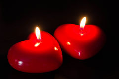 Two red candles in the form of heart Royalty Free Stock Photography
