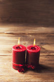 Two red candles tied with red ribbon, the symbol of Valentine`s day, mimics the relationship of men and women Stock Images