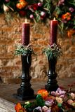 Two red candles on a wooden table stock photo