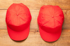 Two red caps Royalty Free Stock Photos
