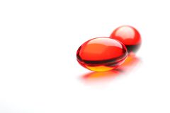 Two Red Capsules Royalty Free Stock Image