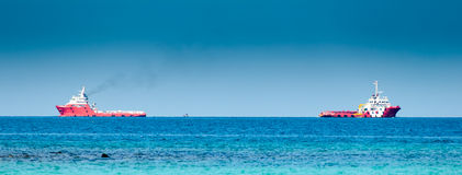 Two red cargo ship on the sea Stock Images