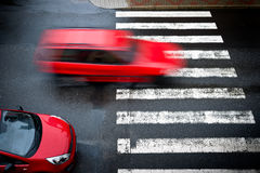 Two red cars on the pedestrian crossing Royalty Free Stock Photos
