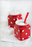Two red ceramic storage jars Royalty Free Stock Image
