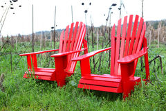 Two Red Chairs in Countryside Royalty Free Stock Photos