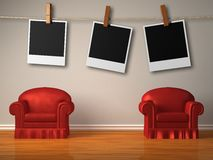 Two red chairs with instant photo's frames Stock Image