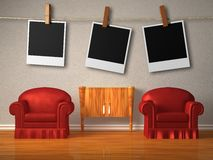 Two red chairs with instant photo's frames Stock Photo