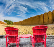 Two red chaise lounges Royalty Free Stock Photo