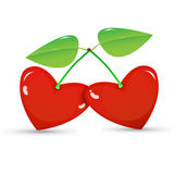 Two red cherries in a heart shape Royalty Free Stock Images