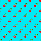 Two red cherries with leaves on blue background seamless pattern Royalty Free Stock Images
