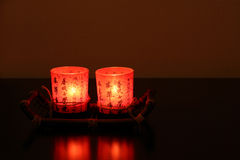 Two red chinese decorative candles in darkness. Royalty Free Stock Photography