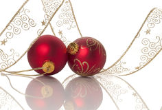 Two Red Christams balls wrapped in Ribbon Royalty Free Stock Photos