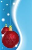 Two red Christmas ball on a blue background Stock Image