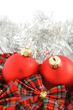 Two red Christmas balls. With check ribbon and silver decoration on white background stock photo