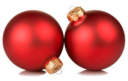 Two red christmas balls. Isolated on white background Royalty Free Stock Images