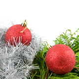 Two red christmas balls with branches and ribbon Stock Image