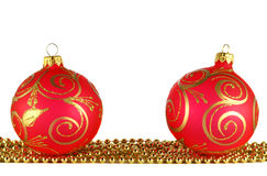 Two red christmas balls and golden garland Royalty Free Stock Images