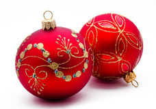 Two red christmas balls isolated Royalty Free Stock Images