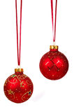 Two red Christmas balls on a red ribbon Royalty Free Stock Photo