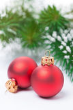 Two red Christmas balls on a white background, selective focus Stock Image
