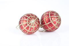 Two red Christmas baubles Stock Photography