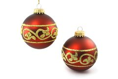 Two red christmas baubles Stock Photos