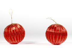 Two red Christmas baubles on white Royalty Free Stock Photos