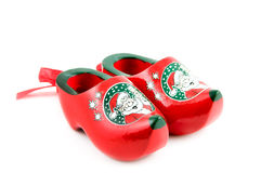 Two red christmas clogs Stock Photos