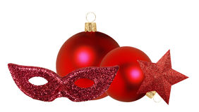 Two red Christmas decor balls, star and mask isolated on white b Stock Image