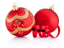 Two Red Christmas decoration baubles and curling paper isolated. On a white background stock photo