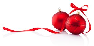 Two red Christmas decoration baubles with ribbon bow isolated on royalty free stock images