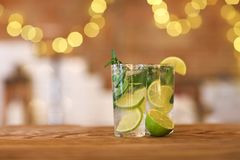 Two cocktail glasses on wooden bar counter Stock Images
