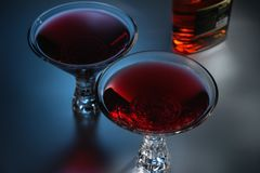 Red cocktails on dark background royalty free stock image