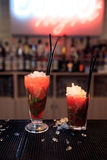Two red cocktails with ice. In bar Stock Image