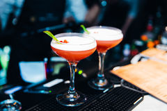 Two Red Colourful cocktails served in nightclub royalty free stock photos