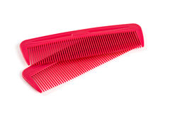 Two red combs for hair isolated on white. Background Stock Photos