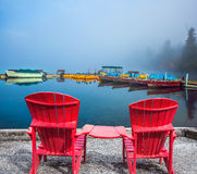 Two red comfortable sun loungers Royalty Free Stock Photo