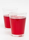 Two red cranberry fruit drinks Stock Photography
