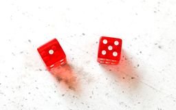 Two red craps dices showing Easy Six Jimmie Hicks number 1 and 5 overhead shot on white board stock image