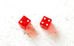 Two red craps dices showing Easy Six Jimmie Hicks number 2 and 4 overhead shot on white board royalty free stock photo