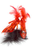 Two red crystal slippers with feathers Stock Photo