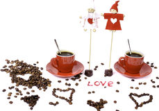 Two red cups of coffee, coffee beans and chocolate hearts. Stock Image