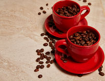 Two red cups of coffee Royalty Free Stock Images
