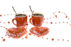 Two red cups of coffee and two hearts on a white background. Royalty Free Stock Photography