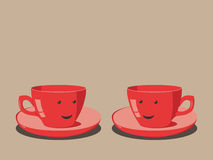 Two red cups smiling Royalty Free Stock Photo