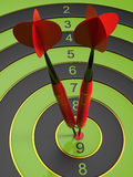 The two red darts hitting the bullseye. 3d illustration Stock Image
