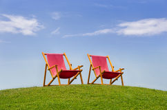 Two red deckchairs Royalty Free Stock Image